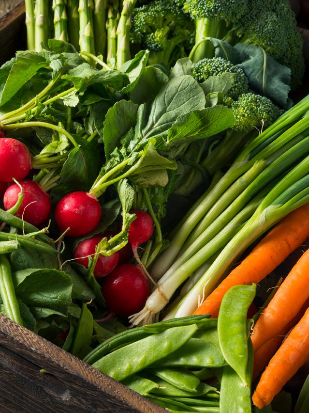Wooden box full of Farmers' Market fresh vegetables